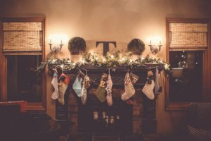 Stockings hung on a family's fireplace mantle