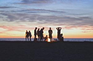 friends around a campfire on the beach